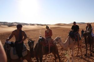 Camel riding to our Berber camp in the Sahara Desert